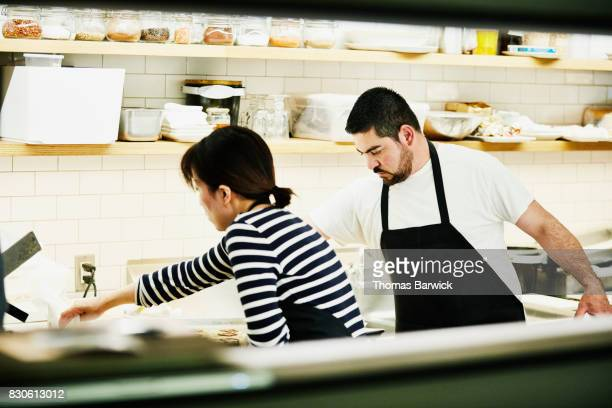 Chefs working together in kitchen before restaurant opening