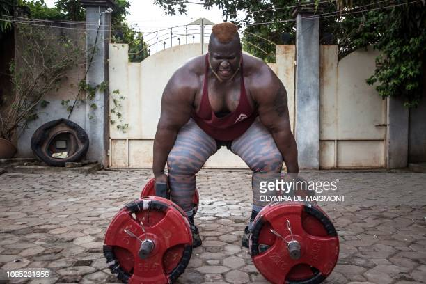 Cheick Ahmed AlHassan Sanou aka Iron Biby prepares to lift 300 kg as he works out at his home of BoboDioulasso second biggest city of Burkina Faso on...