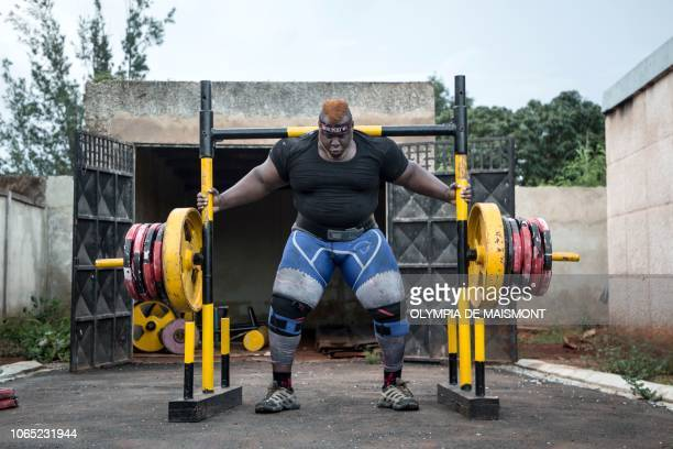Cheick Ahmed AlHassan Sanou aka Iron Biby prepares to lift 505 kg as he works out at his home of BoboDioulasso second biggest city of Burkina Faso on...