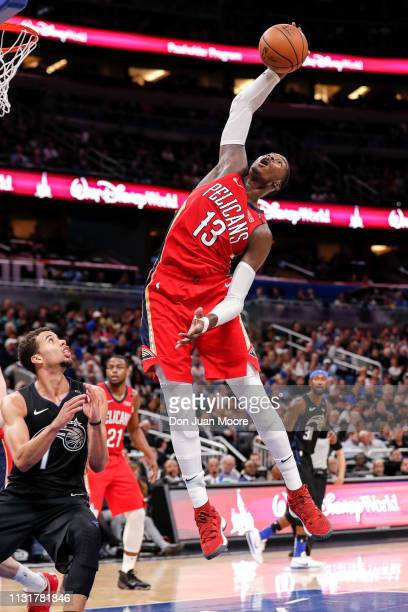 Cheick Diallo of the New Orlean Pelicans grabs a rebound over Michael CarterWilliams of the Orlando Magic during the game at the Amway Center on...