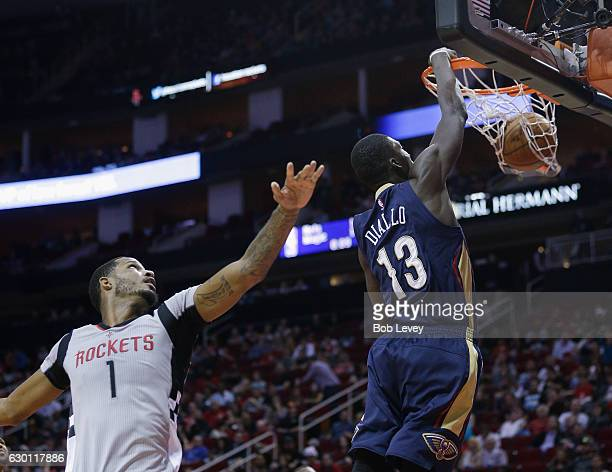 Cheick Diallo of the New Orleans Pelicans drives past Trevor Ariza of the Houston Rockets for a dunk at Toyota Center on December 16 2016 in Houston...