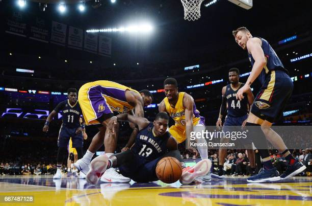 Cheick Diallo of the New Orleans Pelicans scrambles for the ball with Tarik Black and David Nwaba of the Los Angeles Lakers during the second half of...