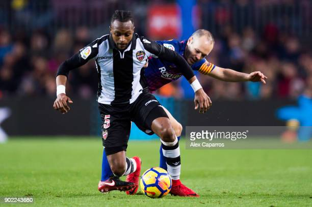 Cheick Doukoure of Levante UD protects the ball from Andres Iniesta of FC Barcelona during the La Liga match between Barcelona and Levante at Camp...