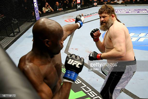 Cheick Kongo of France battles against Roy Nelson in their heavyweight bout during the UFC 159 event at the Prudential Center on April 27 2013 in...
