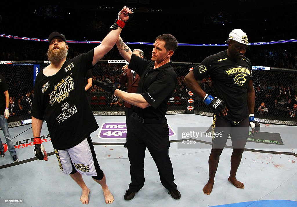 Cheick Kongo (R) of France reacts as Roy Nelson (L) is announced winner by knockout by referee Kevin Mulhall (C) after their heavyweight bout during the UFC 159 event at the Prudential Center on April 27, 2013 in Newark, New Jersey.
