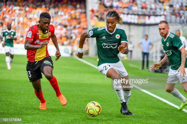Cheick Oumar Doucoure of Lens and Julio Donisa of Red Sar during the Ligue 2 match between Lens and Red Star at Stade BollaertDelelis on August 4...