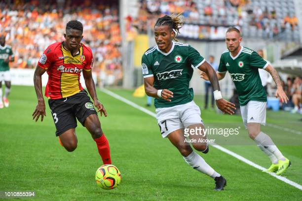 Cheick Oumar Doucoure of Lens and Julio Donisa of Red Star during the Ligue 2 match between Lens and Red Star at Stade BollaertDelelis on August 4...