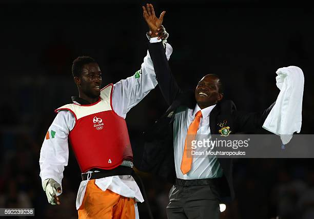 Cheick Sallah Cisse of Cote d'Ivoire celebrates winning the Men's Taekwondo 80kg Gold Medal Contest match against Lutalo Muhammad of Great Britain on...