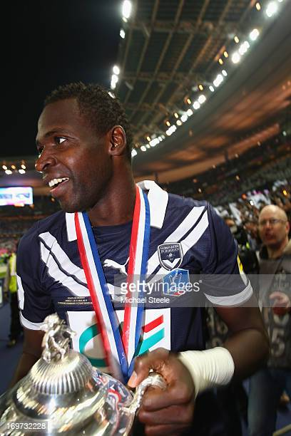 Cheick Tidiane Diabate of Bordeaux scorer of two goals celebrates with the winners trophy after his sides 3-2 victory in the French Cup Final match...