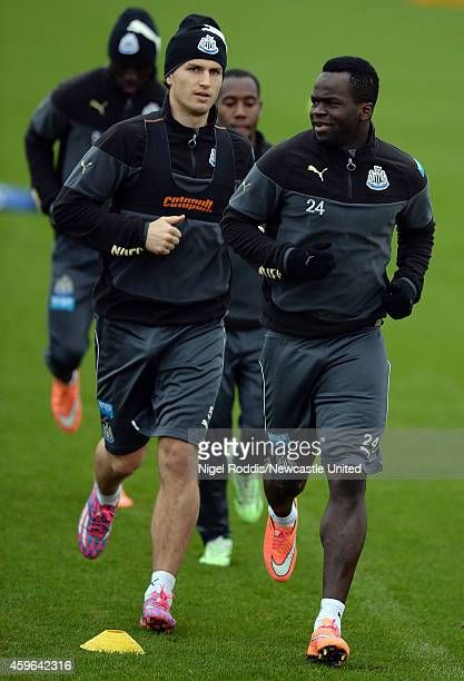Cheick Tiote and Daryl Janmaat of Newcastle United during a training session at The Newcastle United Training Centre on November 27 2014 in Newcastle...