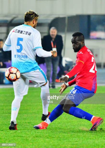 Cheick Tiote of Beijing Enterprises vies for the ball during 2017 China League One round 2nd match between Beijing Enterprises Group FC and Dalian...