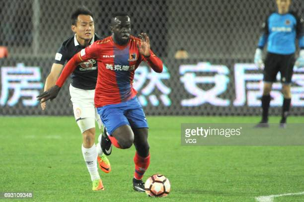 Cheick Tiote of Beijing Enterprises vies for the ball during 2017 China League One round 6th match between Beijing Enterprises Group FC and Beijing...
