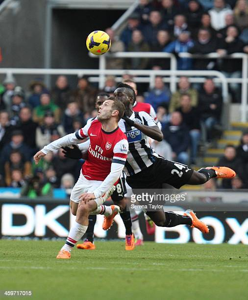 Cheick Tiote of Newcastle challenges Jack Wilshere of Arsenal during the Barclays Premier League match between Newcastle United and Arsenal at St...