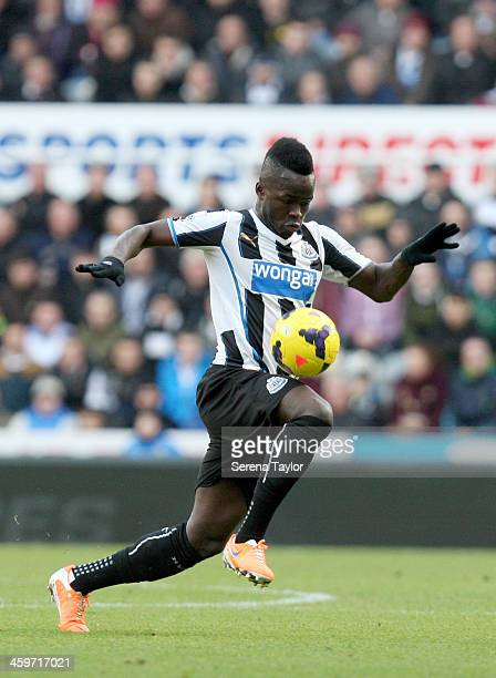 Cheick Tiote of Newcastle controls the ball during the Barclays Premier League match between Newcastle United and Arsenal at St James' Park on...