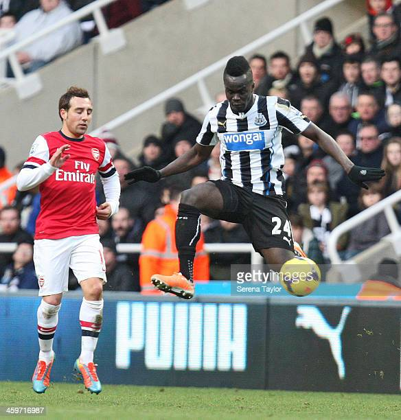 Cheick Tiote of Newcastle intercepts the ball during the Barclays Premier League match between Newcastle United and Arsenal at St James' Park on...