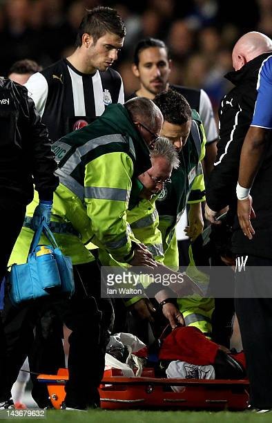 Cheick Tiote of Newcastle receives medical treatment during the Barclays Premier League match between Chelsea and Newcastle United at Stamford Bridge...