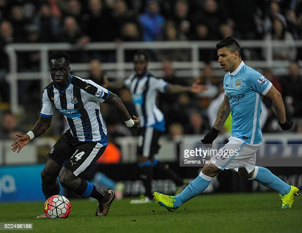 Cheick Tiote of Newcastle runs with the ball while Sergio Aguero is in pursuit during the Barclays Premier League match between Newcastle United and...