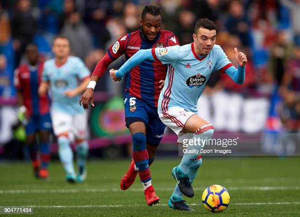 Cheik Doukoure of Levante competes for the ball with Iago Aspas of Celta de Vigo during the La Liga match between Levante and Celta de Vigo at Ciutat...