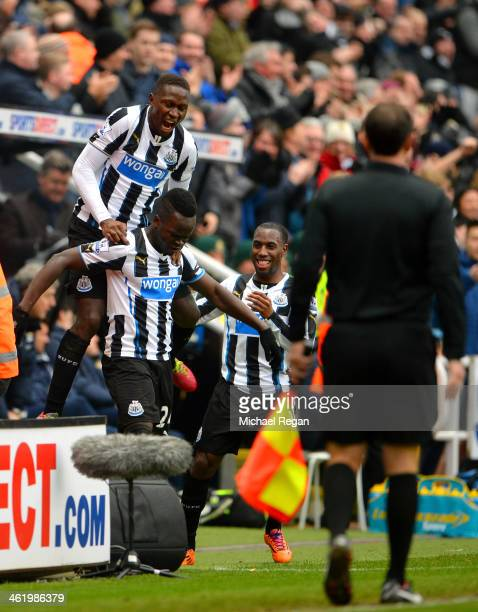 Cheik Ismael Tiote of Newcastle celebrates with teammates after scoring only for the goal to be ruled out for offside during the Barclays Premier...