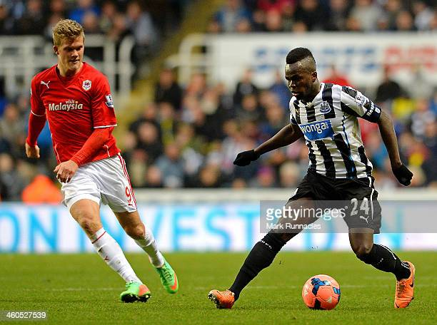 Cheik Ismael Tiote of Newcastle isclosed down by Andreas Cornelius of Cardiff during the Budweiser FA Cup third round match between Newcastle United...