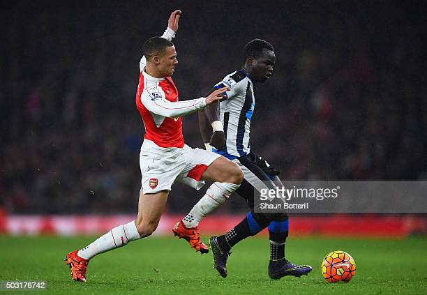 Cheik Ismael Tiote of Newcastle United and Kieran Gibbs of Arsenal compete for the ball during the Barclays Premier League match between Arsenal and...