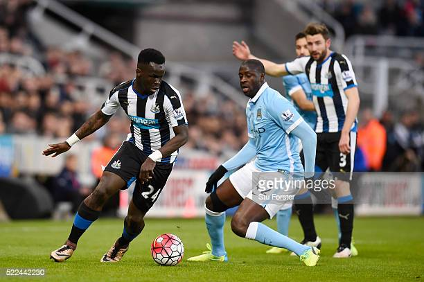 Cheik Ismael Tiote of Newcastle United goes past Yaya Toure of Manchester City during the Barclays Premier League match between Newcastle United and...
