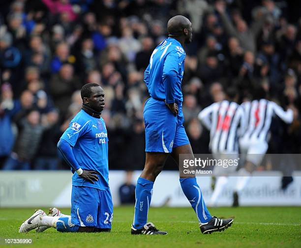 Cheik Tiote and Sol Campbell of Newcastle United look on as West Bromwich Albion celebrate their first goal during the Barclays Premier League match...