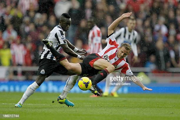Cheik Tiote of Newcastle and Lee Cattermole of Sunderland challenge for the ball during the Barclays Premier League match between Sunderland and...