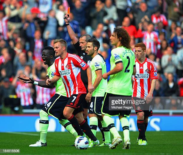 Cheik Tiote of Newcastle is sent off by referee Martin Atkinson during the Barclays Premier League match between Sunderland and Newcastle United at...