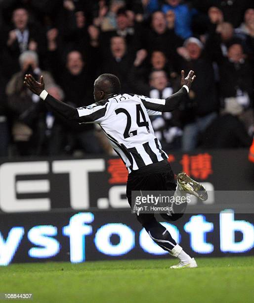 Cheik Tiote of Newcastle United celebrates scoring the equalizing goal during the Barclays Premier league match between Newcastle United and Arsenal...
