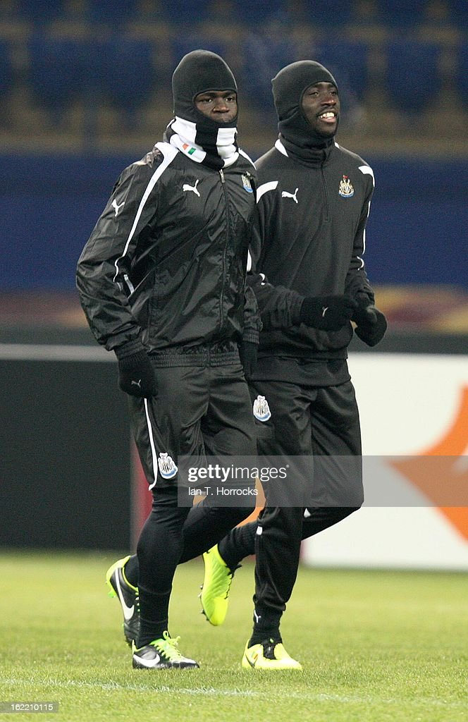 Cheik Tiote of Newcastle United FC with Papis Cisse (right) during a training session ahead of their UEFA Europa League round of 32 second leg match against FC Metalist Kharkiv, at Metalist Stadium, on February 20, 2013 in Kharkov, Ukraine.