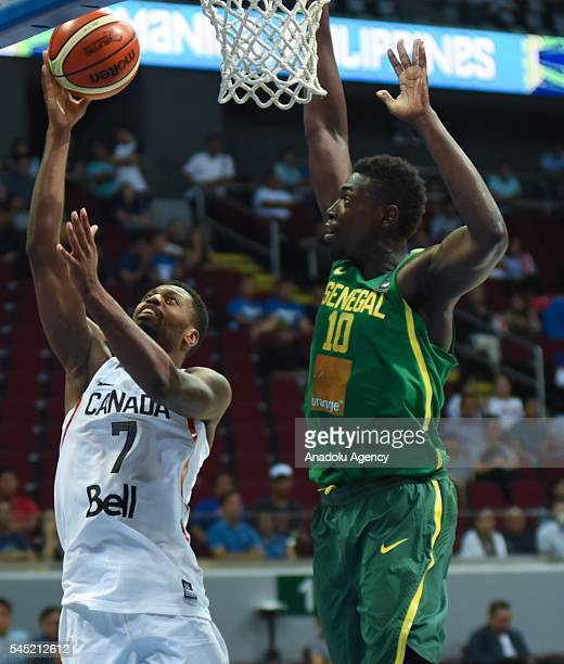 Cheikh Mbodj of Senegal attempts to block the shot of Melvin Ejim of Canada during their match for the FIBA 2016 Olympic Qualifying Tournament held...