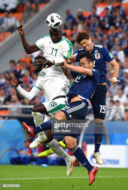 Cheikh Ndoye and Mbaye Niang of Senegal clash with Yuya Osako and Maya Yoshida of Japan during the 2018 FIFA World Cup Russia group H match between...