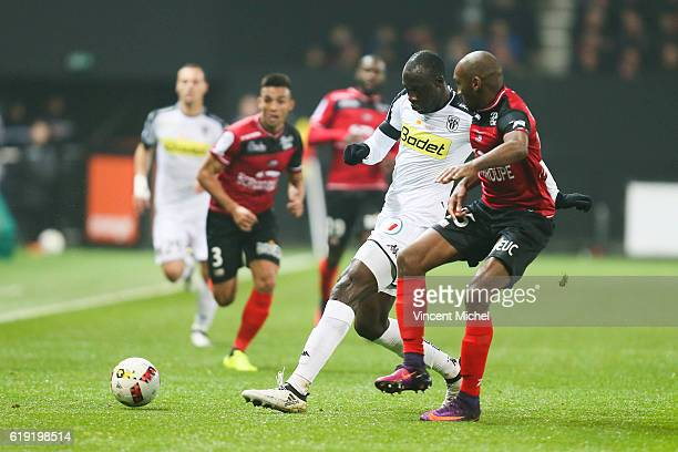 Cheikh Ndoye of Angers and Jeremy Sorbon of Guingamp during the Ligue 1 match between Guingamp and Angers at Stade du Roudourou on October 29 2016 in...