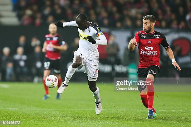 Cheikh Ndoye of Angers and Lucas Deaux of Guingamp during the Ligue 1 match between Guingamp and Angers at Stade du Roudourou on October 29 2016 in...
