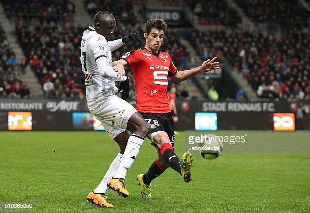 Cheikh N'Doye of Angers and Yoann Gourcuff of Rennes in action during the French Ligue 1 match between Stade Rennais FC and SCO Angers at Roazhon...