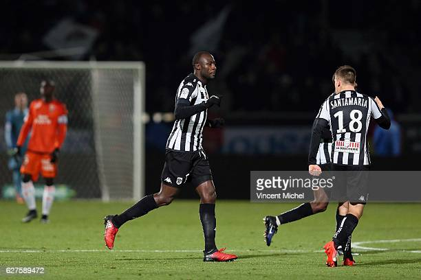 Cheikh Ndoye of Angers jubilates with teammates after scoring the second goal during the Ligue 1 match between Angers SCO and FC Lorient on December...