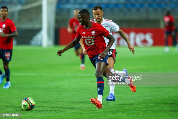 Cheikh Niasse of LOSC Lille tries to escape Haris Seferovic of SL Benfica during the Pre-Season Friendly match between SL Benfica and Lille at...