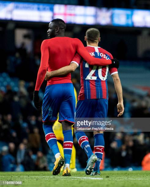 Cheikhou Kouyaté and Cenk Tosun of Crystal Palace during the Premier League match between Manchester City and Crystal Palace at Etihad Stadium on...
