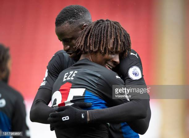 Cheikhou Kouyaté and Eberechi Eze of Crystal Palace embrace after Eze scores the second goal during the Premier League match between Sheffield United...