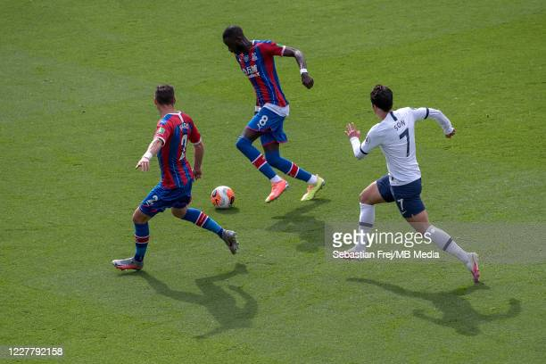 Cheikhou Kouyate and Joel Ward of Crystal Palace and Son MinHeung of Tottenham Hotspur in action during the Premier League match between Crystal...