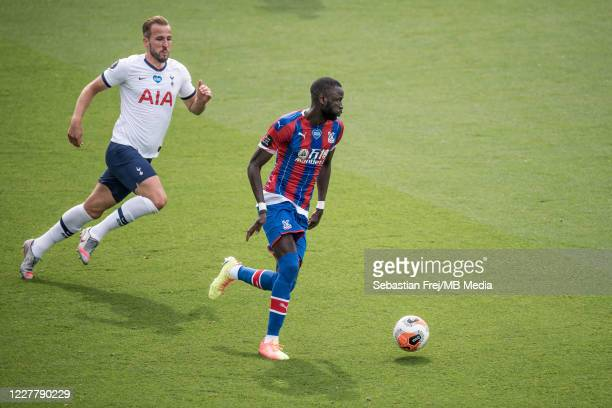 Cheikhou Kouyate of Crystal Palace and Harry Kane of Tottenham Hotspur in action during the Premier League match between Crystal Palace and Tottenham...