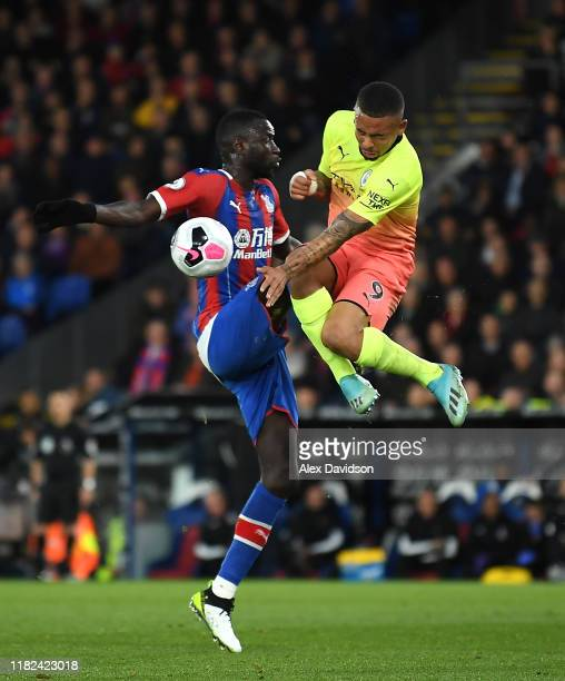 Cheikhou Kouyate of Crystal Palace battles for possession in the air with Gabriel Jesus of Manchester City during the Premier League match between...