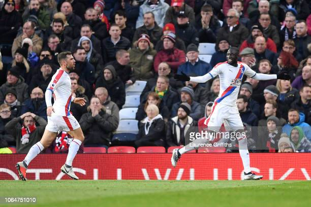 Cheikhou Kouyate of Crystal Palace celebrates after scoring his team's first goal which is then disallowed for offside during the Premier League...