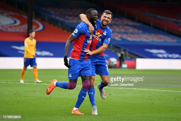 Cheikhou Kouyate of Crystal Palace celebrates with teammate James McArthur after scoring his team's first goal during the Premier League match...