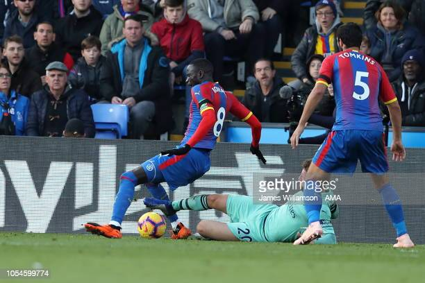 Cheikhou Kouyate of Crystal Palace is fouled in the box by Shkodran Mustafi of Arsenal during the Premier League match between Crystal Palace and...