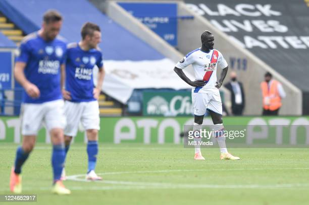 Cheikhou Kouyate of Crystal Palace looks dejected after his side concede a third goal during the Premier League match between Leicester City and...