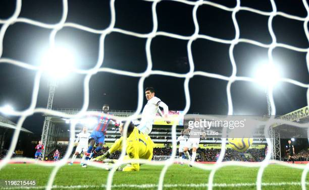 Cheikhou Kouyate of Crystal Palace scores his sides first goal during the Premier League match between Crystal Palace and West Ham United at Selhurst...