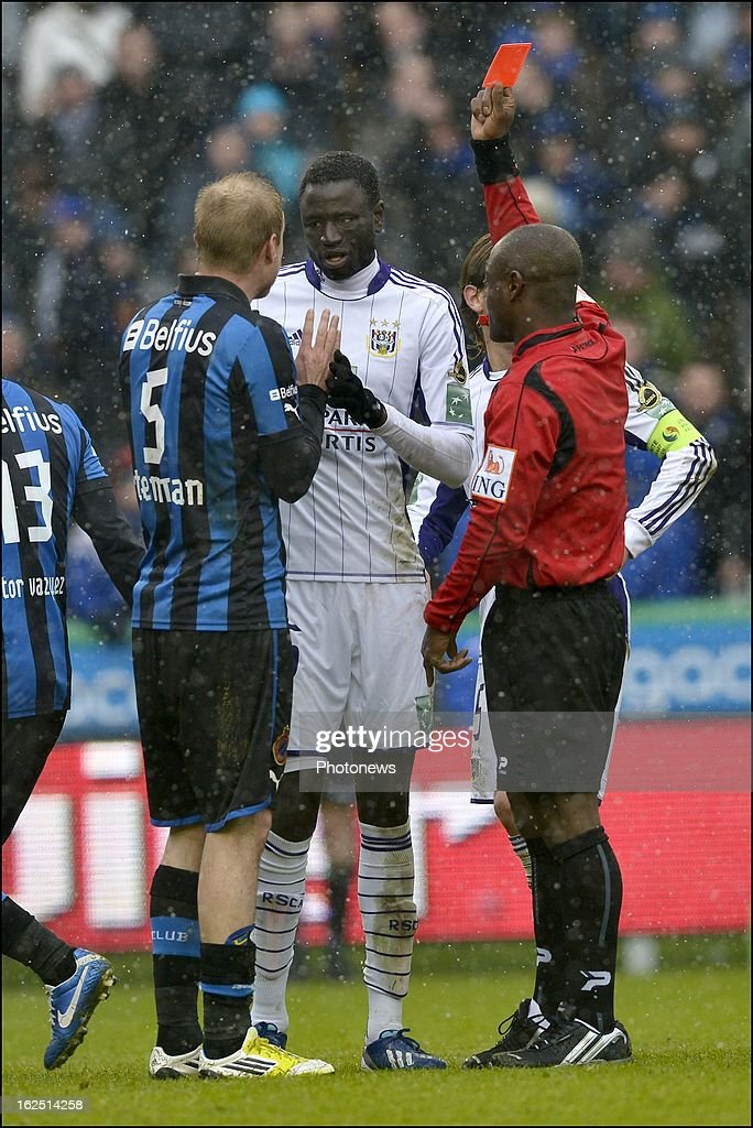 Cheikhou Kouyate of RSC Anderlecht is shown a red card by referee Jerome Nzolo during the Jupiler League match between Club Brugge and RSC Anderlecht on February 24, 2013 in the Jan Breydel Stadium in Brugge, Belgium.