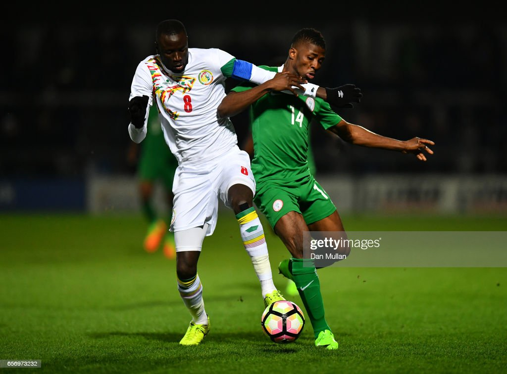 Cheikhou Kouyate of Senegal (L) battles for the ball with Kelechi Iheanacho of Nigeria during the International Friendly match between Nigeria and Senegal at The Hive on March 23, 2017 in Barnet, England.
